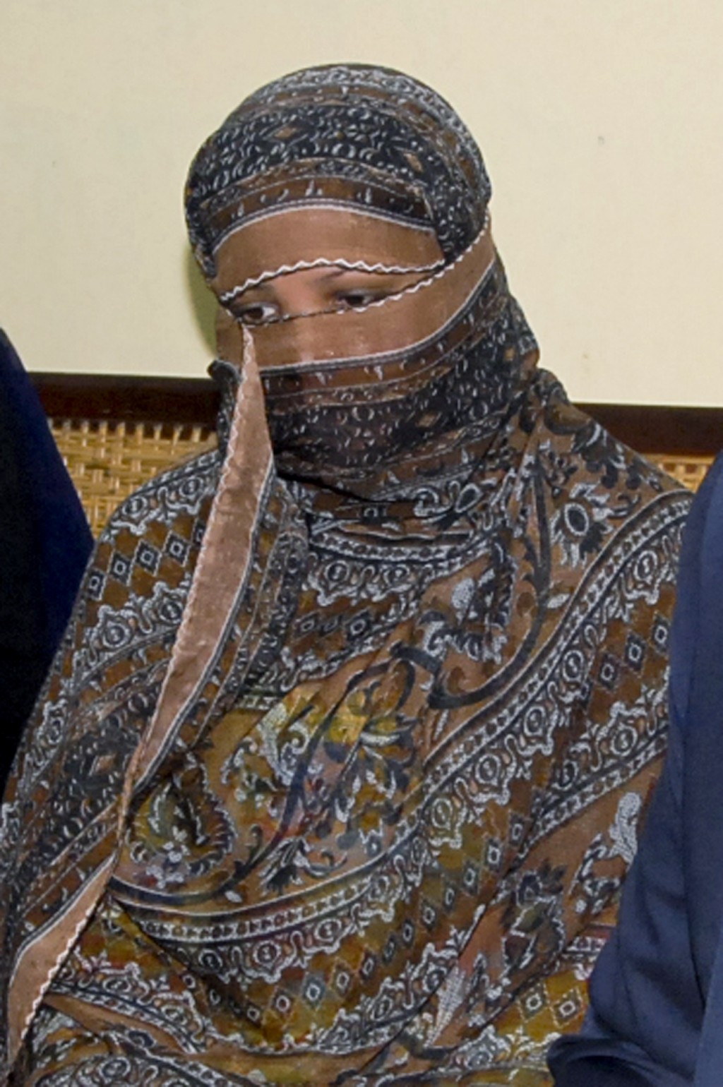 FILE - In this Nov. 20, 2010, file photo, Asia Bibi, a Pakistani Christian woman, listens to officials at a prison in Sheikhupura near Lahore, Pakista