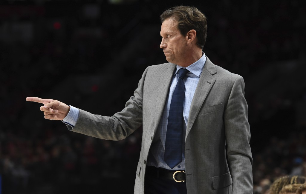 Utah Jazz head coach Quin Snyder directs his team during the first half of an NBA basketball game against the Portland Trail Blazers in Portland, Ore.