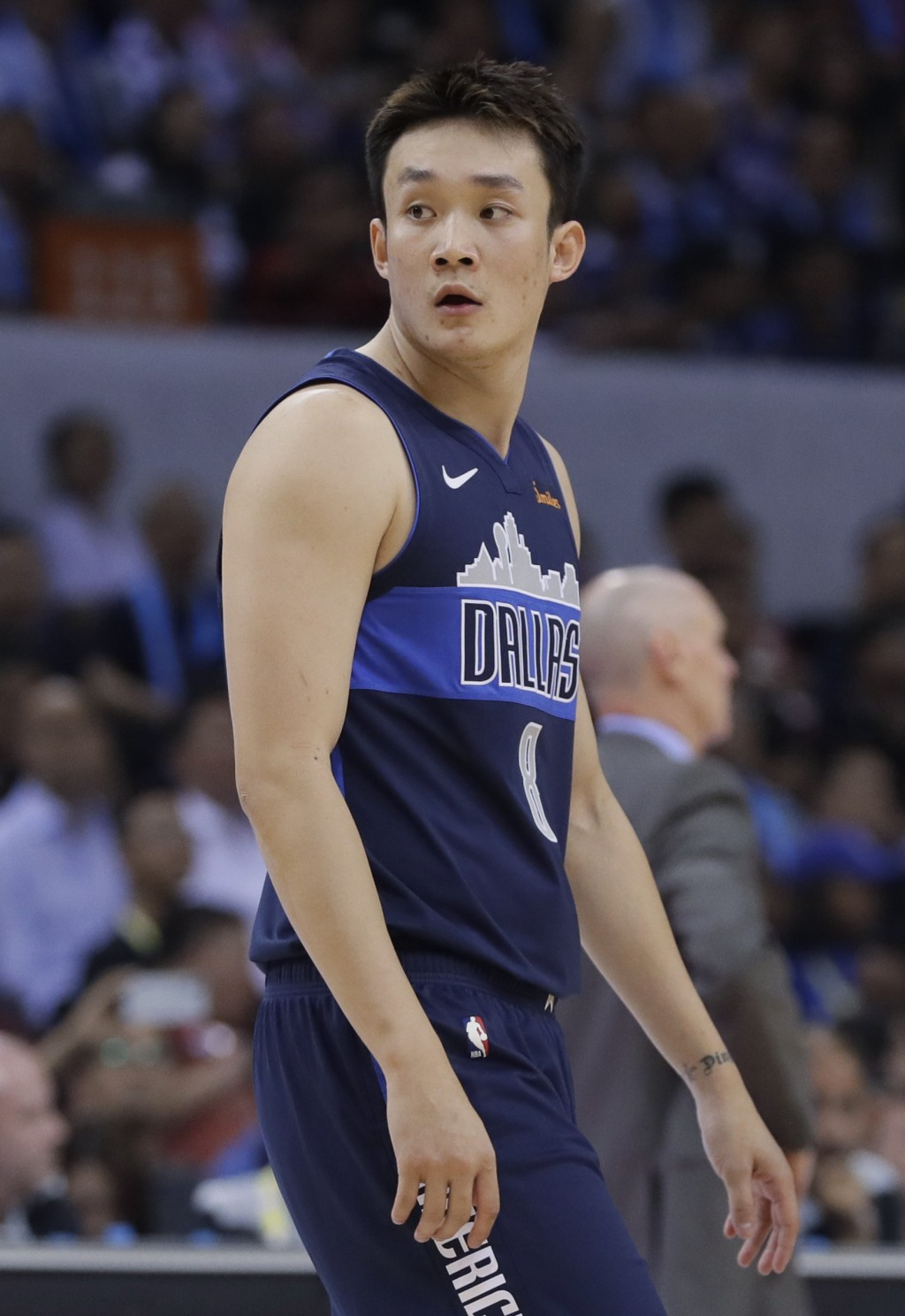 Ding Yanyuhang of Dallas Mavericks, looks on during the Shenzhen basketball match of the NBA China Games against Philadelphia 76ers in Shenzhen city,