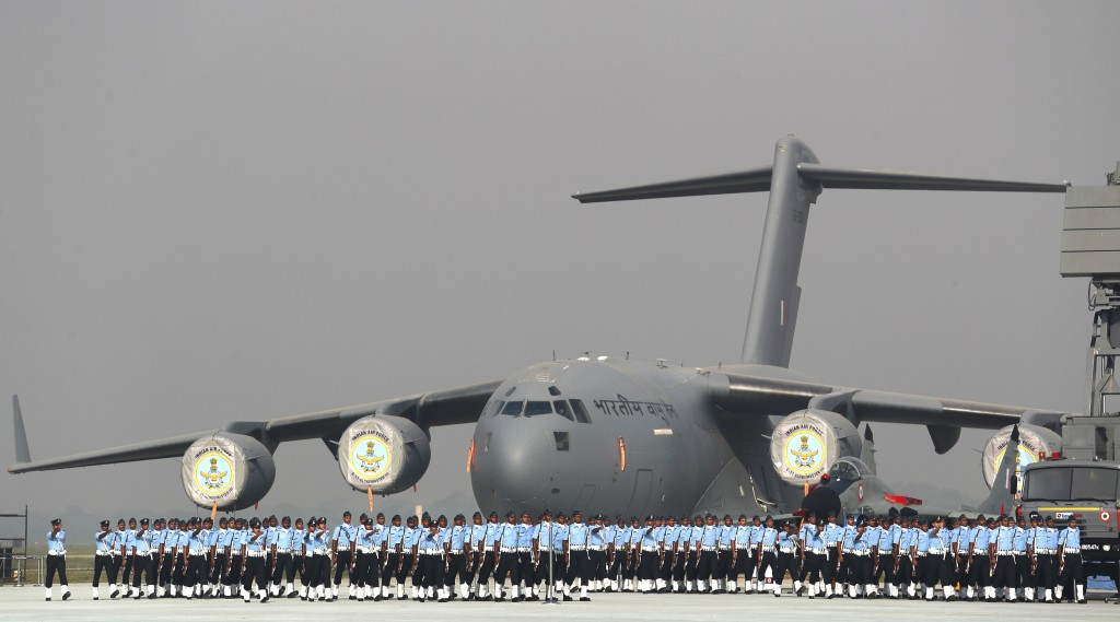 In this Oct. 8, 2018, photo, Indian Air Force soldiers march past their C-17 Globemaster military transport aircraft during the Indian Air Force day p