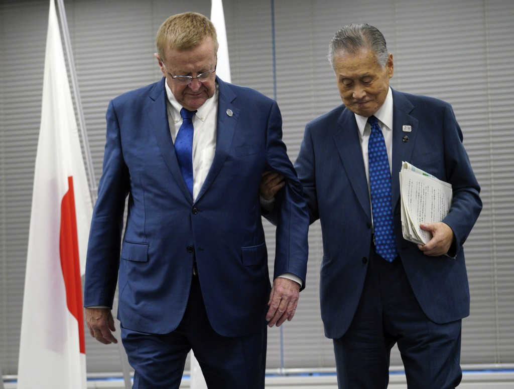 FIEL - In this Sept. 12, 2018, file photo, John Coates, left, chairman of the IOC Coordination Commission for the 2020 Tokyo Olympics and Paralympics ...