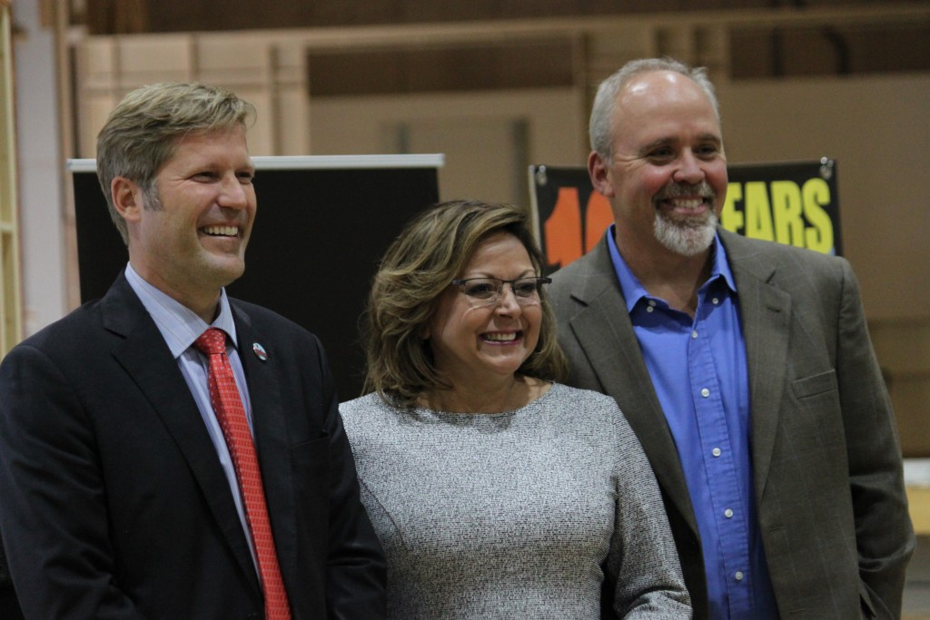 Albuquerque Mayor Tim Keller, from left, Gov. Susana Martinez and Netflix vice president for physical production Ty Warren pose for a photograph follo