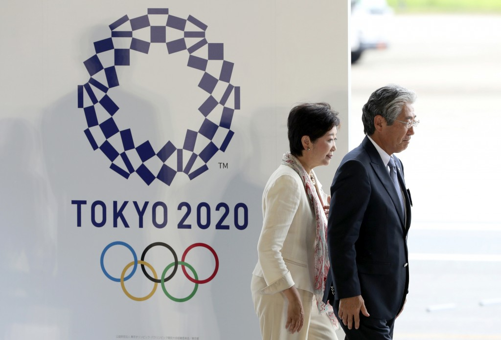FIEL - In this Aug. 24, 201, file photo, Tokyo Gov. Yuriko Koike, second from right, and Tsunekazu Takeda, president of the Japanese Olympic Committee...