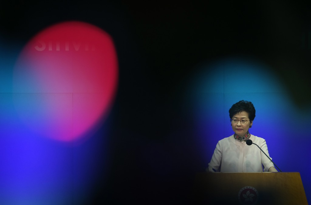 In this Oct. 10, 2018, photo, Hong Kong Chief Executive Carrie Lam attends a question and answer session after delivering her policy speech at the Leg