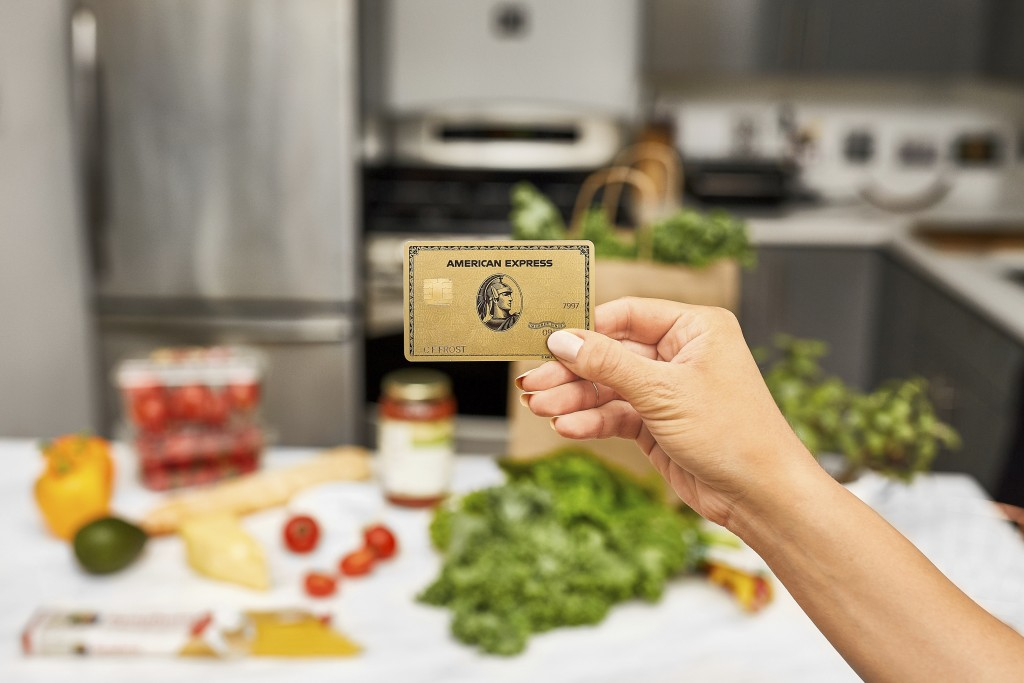 This undated product image provided by American Express shows the new Gold Card, which is getting a major upgrade this fall. It's the latest move by A...
