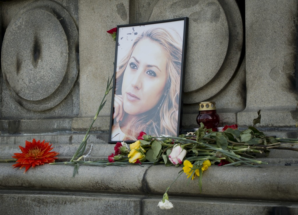 The photo of Viktoria Marinova, the journalist who was raped and strangled on Saturday, is placed on the Liberty Monument in Ruse, Bulgaria, Wednesday