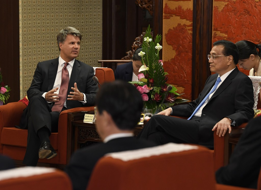 Chinese Premier Li Keqiang, right , meets with Harald Kruger, CEO and chairman of the Board of Management of BMW AG, left back, at the Zhongnanhai lea