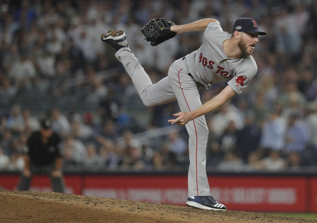 Boston Red Sox pitcher Chris Sale delivers against the New York Yankees during the eighth inning of Game 4 of baseball's American League Division Seri