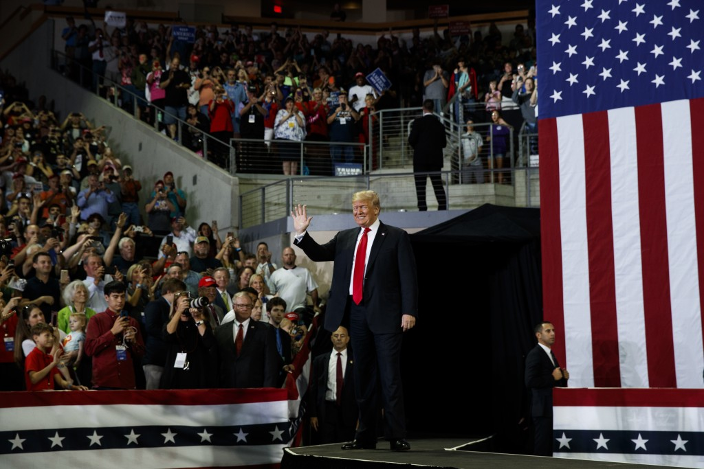 President Donald Trump arrives to speak at a campaign rally at Erie Insurance Arena, Wednesday, Oct. 10, 2018, in Erie, Pa. As Hurricane Michael pound