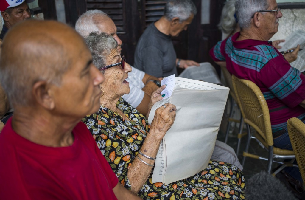 In this Sept. 30, 2018 photo, a woman gives her opinion during a public forum on constitutional reform in Havana, Cuba. The single-party government is