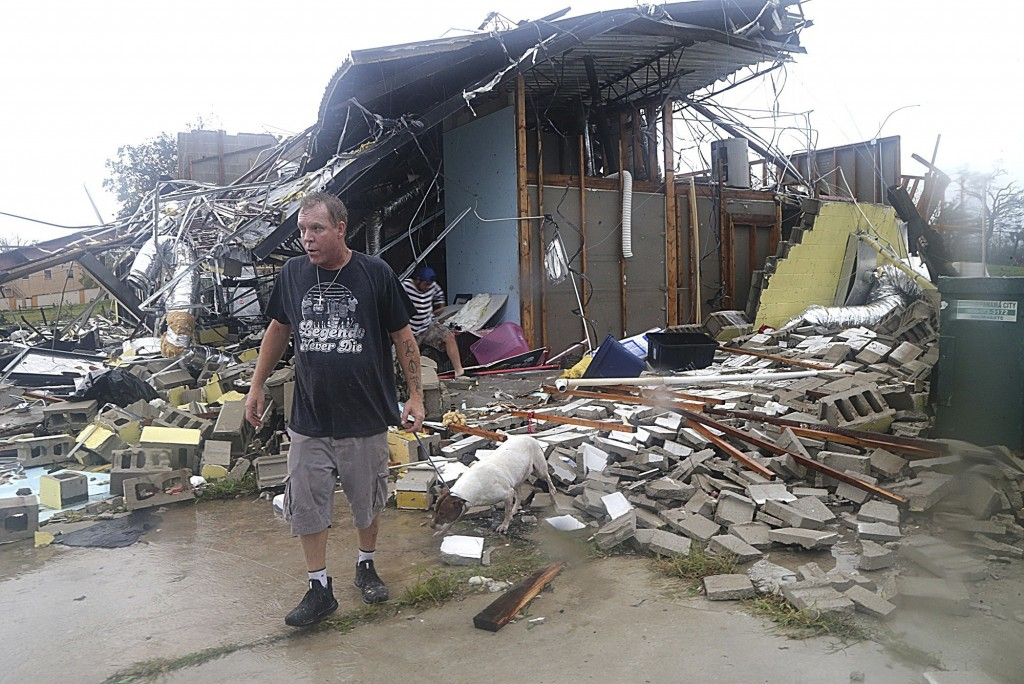 Brian Bon inspects damages in the Panama City downtown area after Hurricane Michael made landfall in Panama City, Fla., Wednesday, Oct. 10, 2018. Supe