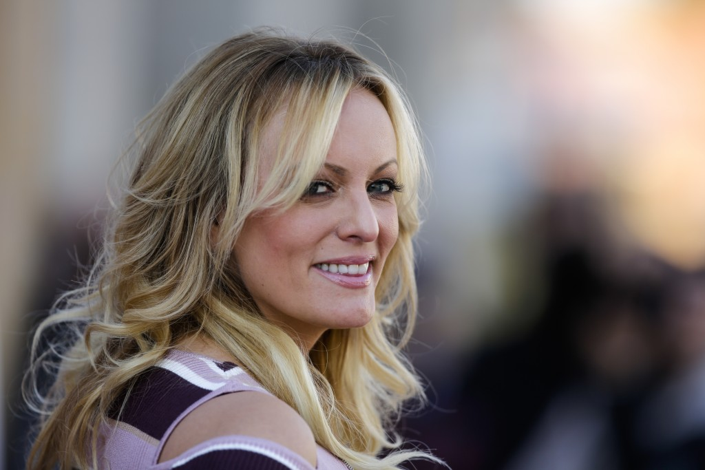 Adult film actress Stormy Daniels attends the opening of the adult entertainment fair 'Venus' in Berlin, Germany, Thursday, Oct. 11, 2018. (AP Photo/M