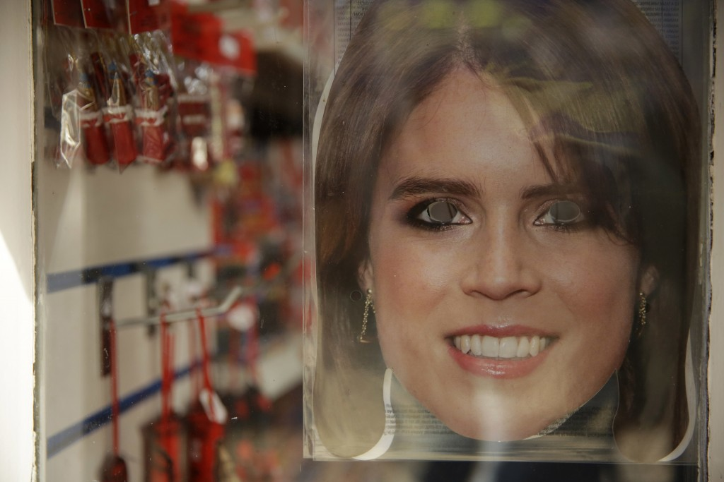 A Princess Eugenie mask is displayed for sale in the window of a souvenir shop ahead of the wedding of Britain's Princess Eugenie in Windsor, England,
