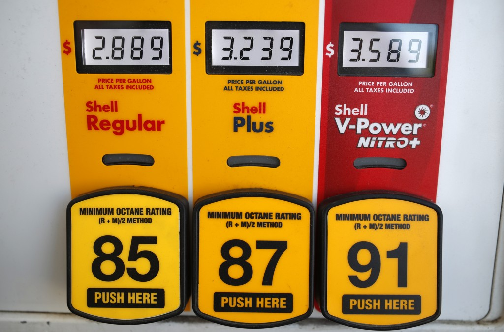 FILE- In this May 25, 2018, file photo prices for the three grades of gasoline light up the pump at a Shell station in southeast Denver. On Thursday,