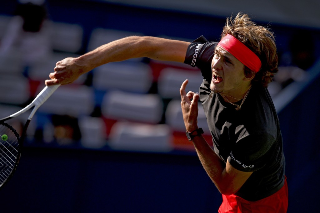 Alexander Zverev of Germany serves against Alex De Minaur of Australia during their men's singles match of the Shanghai Masters tennis tournament at Q