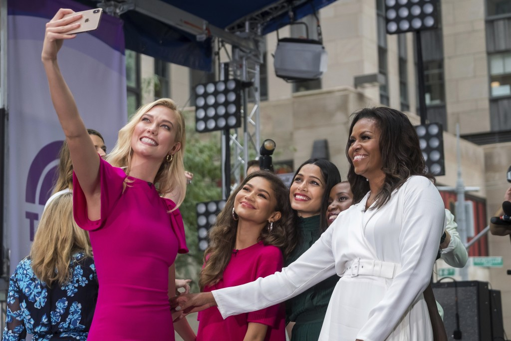 """Karlie Kloss, from left, Zendaya, Freida Pinto, Monica Nyiraguhabwa and Michelle Obama participate in the International Day of the Girl on NBC's """"Toda"""