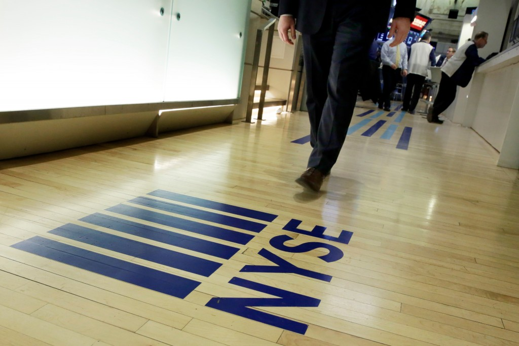 FILE- In this April 5, 2018, file photo a NYSE logo adorns the entrance to the trading floor the New York Stock Exchange. The U.S. stock market opens