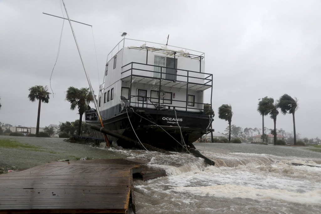 The Oceanis is grounded by a tidal surge at the Port St. Joe Marina, Wednesday, Oct. 10, 2018 in Port St. Joe, Fla. Supercharged by abnormally warm wa