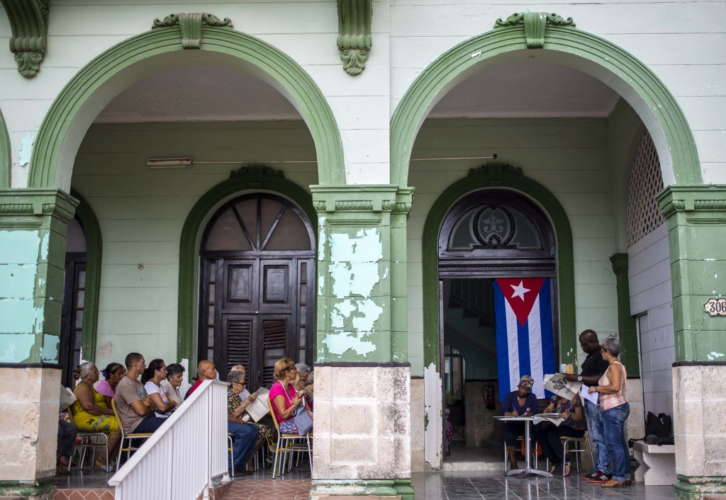 In this Sept. 30, 2018 photo, residents gather for a public forum on constitutional reform in Havana, Cuba. After standing for the national anthem, sp
