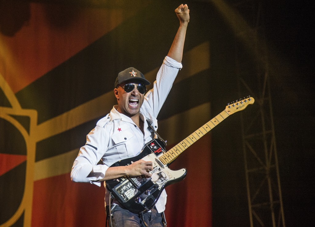 FILE - In this Oct. 1, 2017 file photo, Tom Morello, of Prophets of Rage, performs at the Louder Than Life Music Festival in Louisville, Ky. Morello r