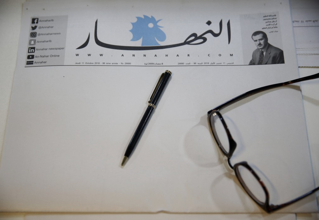 A copy of a blank published An-Nahar newspaper, on a journalist's desk at the paper's headquarters, in downtown Beirut, Lebanon, Thursday, Oct. 11, 20