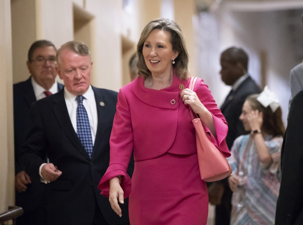 FILE - In this June 26, 2018, file photo, Rep. Barbara Comstock, R-Va., walks to a closed-door GOP strategy session at the Capitol in Washington. Two-