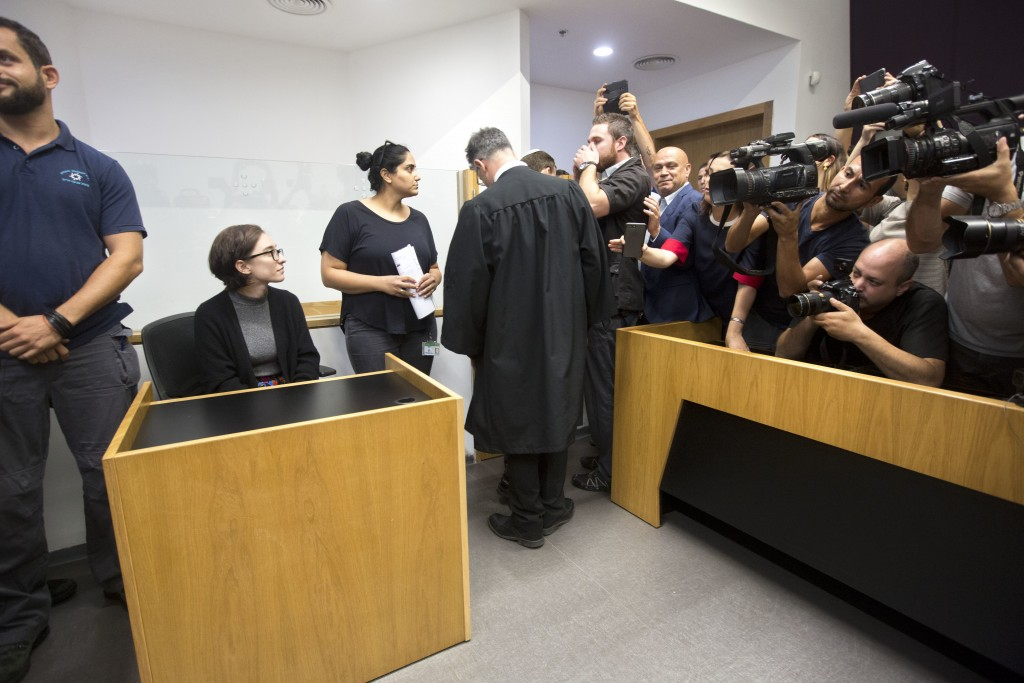 American Lara Alqasem, left, sits in a courtroom prior to a hearing at the district court in Tel Aviv, Israel, Thursday, Oct. 11, 2018. A senior Israe