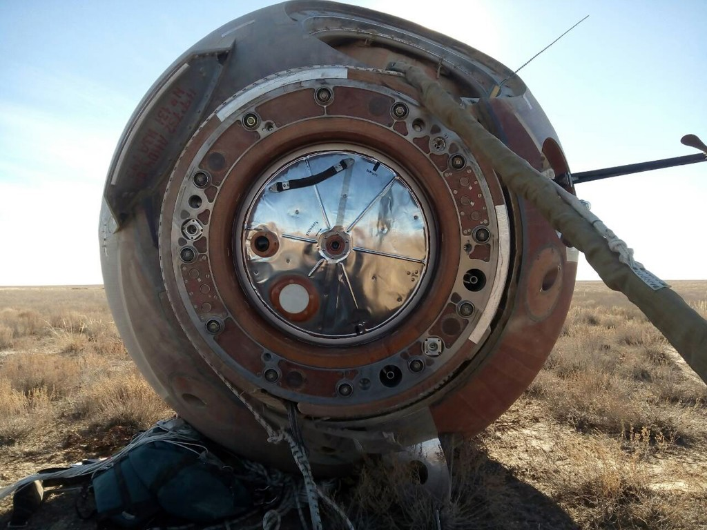 In this photo provided by Russian Defense Ministry Press Service, the Soyuz MS-10 space capsule lays in a field after an emergency landing near Dzhezk