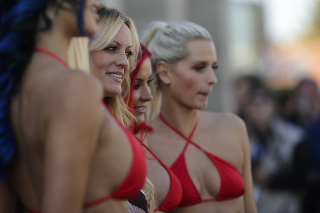 Adult film actress Stormy Daniels, second from left, attends the opening of the adult entertainment fair 'Venus' in Berlin, Germany, Thursday, Oct. 11
