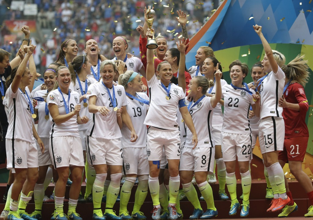 FILE - In this Sunday, July 5, 2015, file photo, the U.S. team celebrates with the trophy after it defeated Japan 5-2 in the FIFA Women's World Cup so