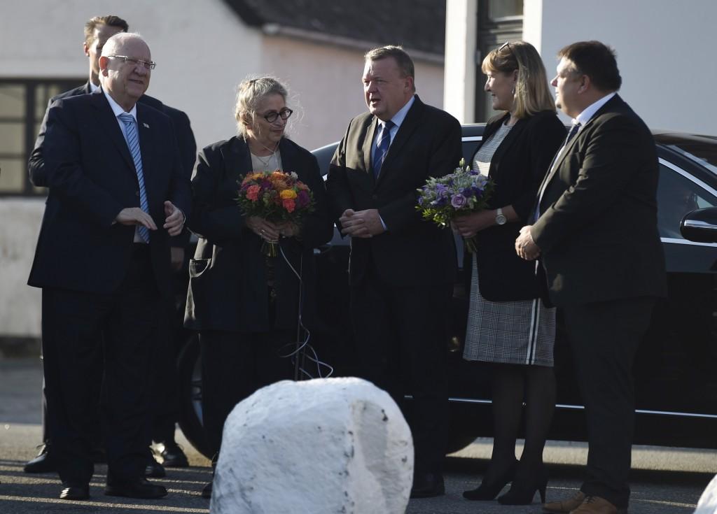 President of Israel, Reuven Rivlin, left, his wife Nechama Rivlin, second left, Denmark's Prime Minister Lars Loekke Rasmussen, center, his wife Solru