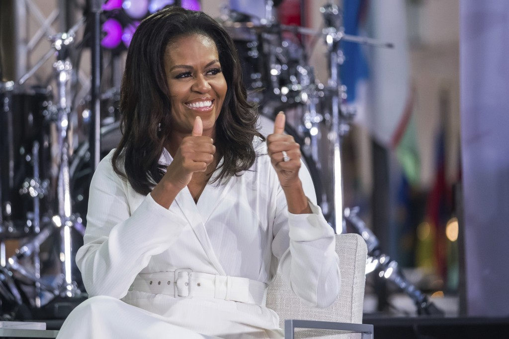 """Michelle Obama participates in the International Day of the Girl on NBC's """"Today"""" show at Rockefeller Plaza on Thursday, Oct. 11, 2018, in New York. ("""