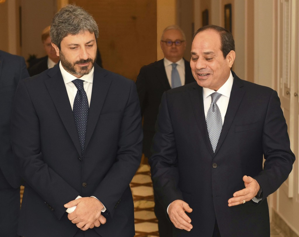 FILE - In this Sept. 17, 2018 file photo, released by the Egyptian Presidency, Egyptian President Abdel-Fattah el-Sissi, right, walks with Roberto Fic