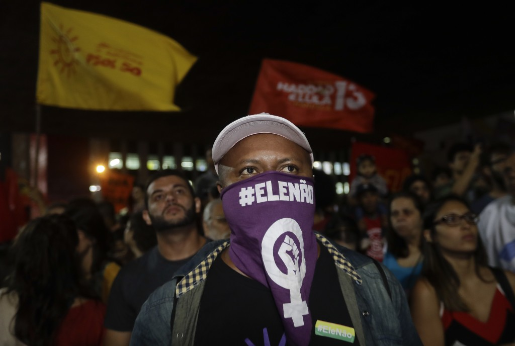 "A man wears a scarf that reads in Portuguese ""Not him"", during a protest against Jair Bolsonaro, a far-right presidential candidate in Sao Paulo, Braz"