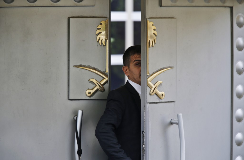 FILE - In this Tuesday, Oct. 9, 2018 file photo, a security guard walks in the Saudi Arabia consulate in Istanbul, Turkey. The disappearance of Khasho