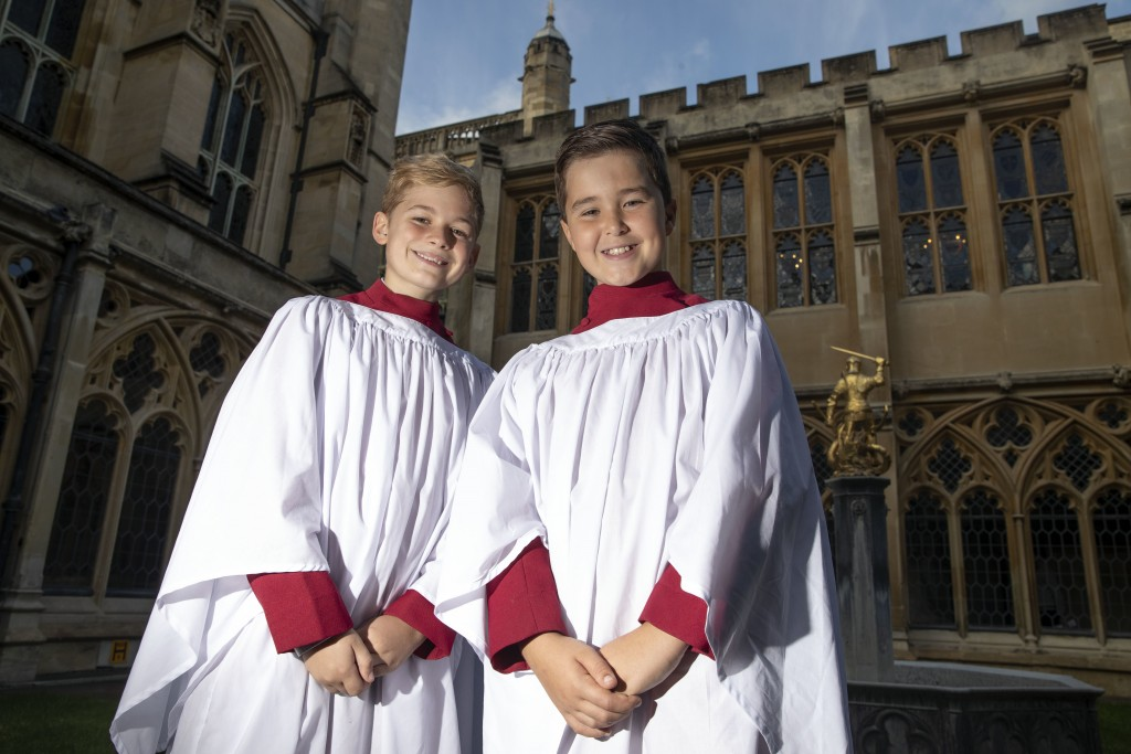 Leo Mills, 12, left, and Alexis Sheppard, 11, choristers of the Windsor Castle chapel choir on Thursday Oct. 11, 2018, who will take part in the weddi