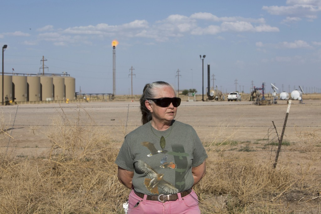 Suzanne Franklin stands near her home in Reeves County, West Texas, on April 11, 2018. Some mornings Franklin wakes with a nose full of dried blood, h