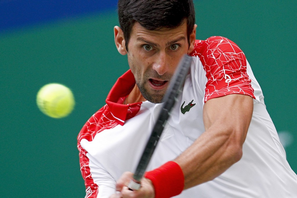 Novak Djokovic of Serbia hits a return shot to Marco Cecchinato of Italy during their men's singles match of the Shanghai Masters tennis tournament at