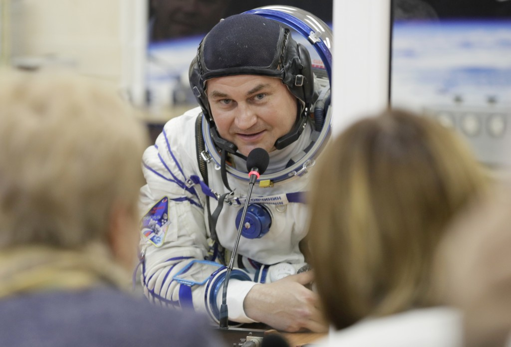 Russian cosmonaut Alexey Ovchinin, a member of the main crew of the expedition to the International Space Station (ISS), speaks with his relatives thr