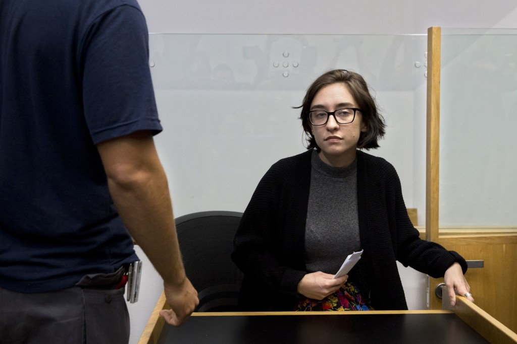 American Lara Alqasem sits in a courtroom prior to a hearing at the district court in Tel Aviv Israel Thursday Oct. 11 2018. A senior Israeli cabi