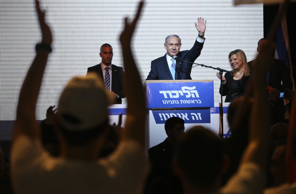 FILE - In this March 17, 2015 file photo, Israeli Prime Minister Benjamin Netanyahu greets supporters at the party's election headquarters in Tel Aviv