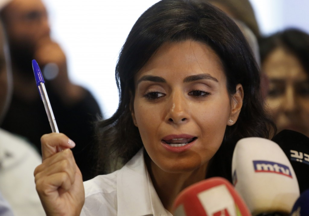 Nayla Tueni, the editor-in-chief of An-Nahar daily newspaper, holds a pen as she speaks during a press conference held at the paper's headquarters, in