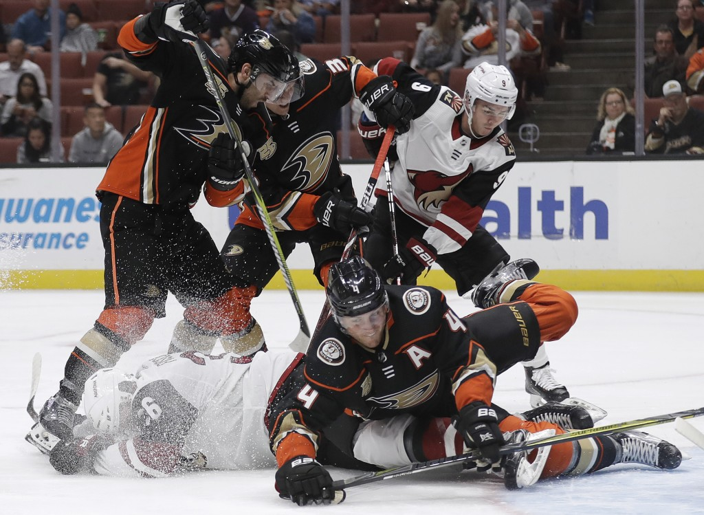 Anaheim Ducks' Cam Fowler .bottom right, collides with Arizona Coyotes' Christian Fischer, bottom left, during the first period of an NHL hockey game