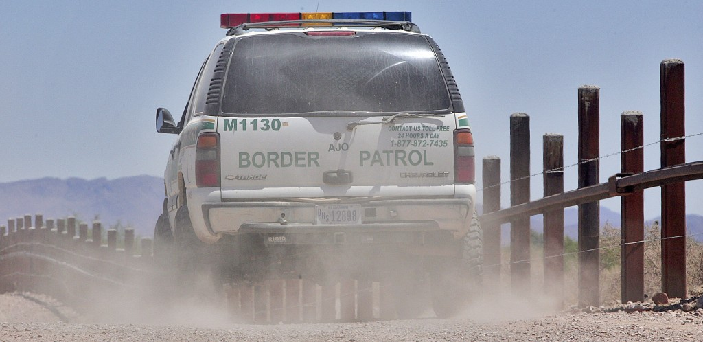 FILE - In this May 26, 2006 file photo, a U.S. Border Patrol agent patrols the international border separating Sonoyta, Mexico, right of fence, and Lu