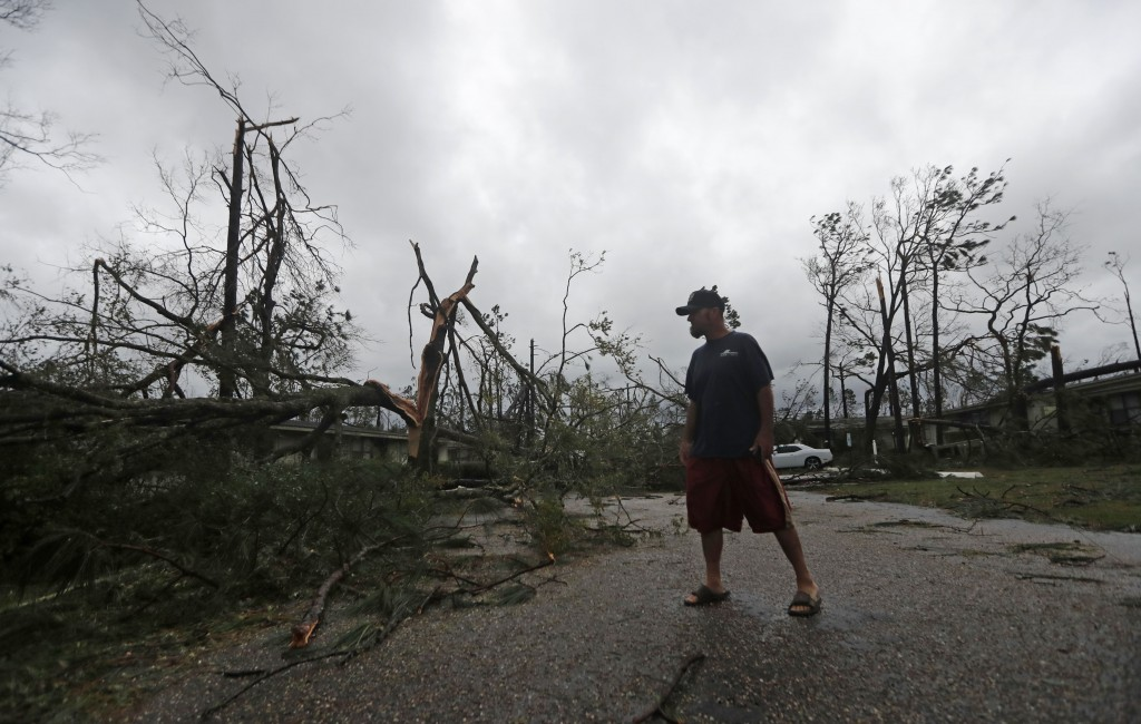 James Prescott surveys the damage as the remnants of Hurricane Michael move through Panama City, Fla., Wednesday, Oct. 10, 2018. He was visiting a fri