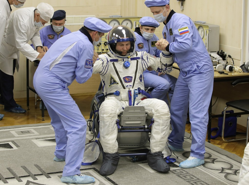 Russian Space Agency experts help U.S. astronaut Nick Hague, a member of the main crew of the expedition to the International Space Station (ISS), to