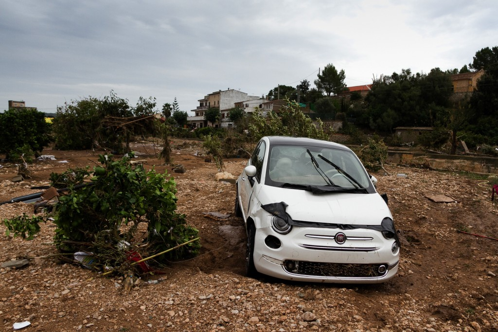 A car on a destroyed crop after flooding in Sant Llorenc, 60 kilometers (40 miles) east of Mallorca's capital, Palma, Spain, Wednesday, Oct. 10, 2018.