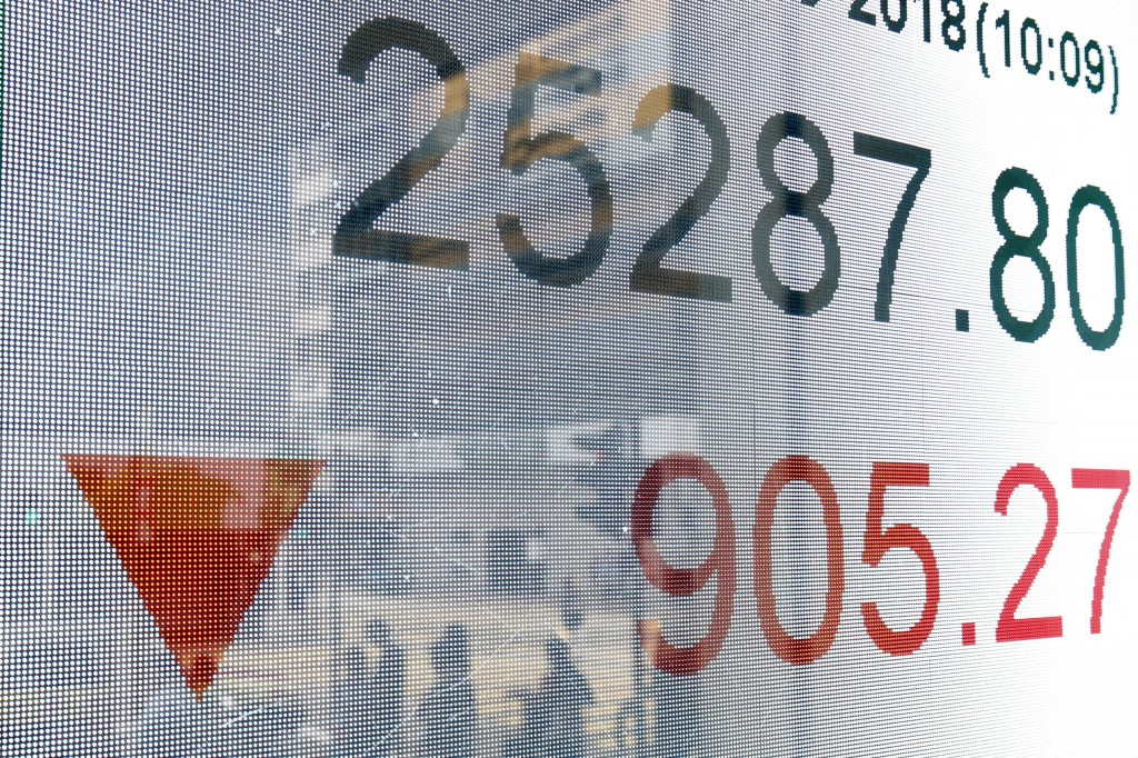 An electronic board shows Hong Kong share index outside a bank In Hong Kong, Thursday, Oct. 11, 2018. Asian markets tumbled on Thursday, after Wall St