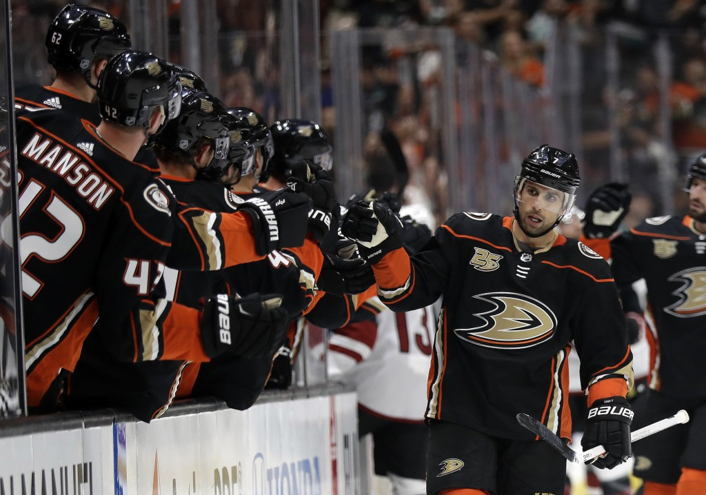 Anaheim Ducks' Ryan Kesler, right, celebrates with teammates after scoring against the Arizona Coyotes during the first period of an NHL hockey game W