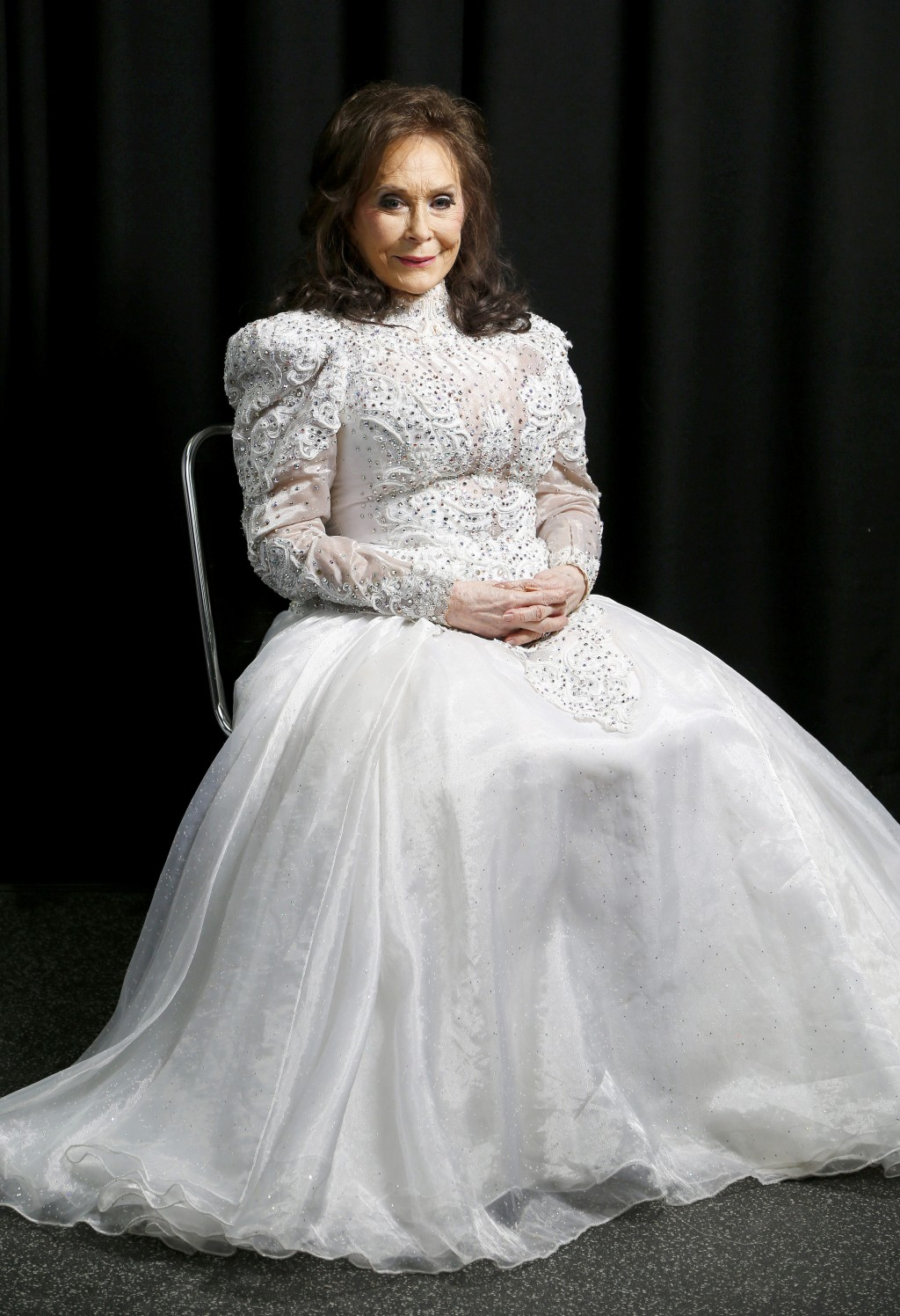 In this Feb. 10, 2016 file photo, Loretta Lynn poses for a photo at the Municipal Auditorium in Nashville, Tenn. Lynn will be recognized as an artist
